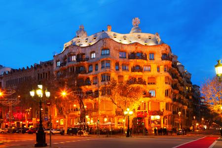 BARCELONA, SPAIN - JANUARY 2, 2014:  Casa Mila (La Pedrera) in night, Barcelona.  House was built in 1905–1910 by Catalan architect Antoni Gaudi