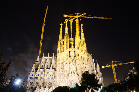 uncomplete: BARCELONA, SPAIN - SEPTEMBER 13, 2014: Sagrada Familia in dark time. Barcelona. Basilica and Expiatory Church of Holy Family by Gaudi, building is begun in 1882