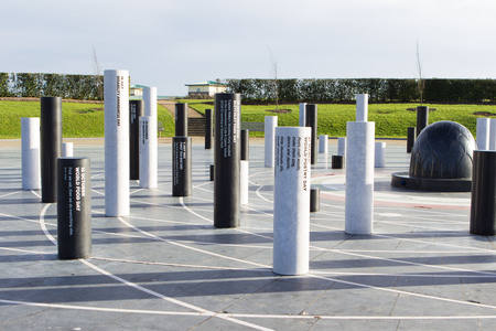 historical events: Milton Keynes, England - January 16, 2015: The MK Rose, created by artist Gordon Young, modern monument with the pillars devoted to different historical events and Light Pyramid at the distance in Milton Keynes, UK