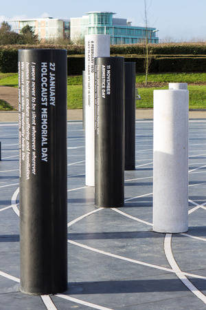 milton: Milton Keynes, England - January 16, 2015: The MK Rose, created by artist Gordon Young, modern monument with the pillars devoted to different historical events and Light Pyramid at the distance in Milton Keynes, UK