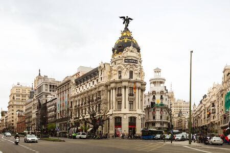 avenues: MADRID, SPAIN - APRIL 26: Crossing the Calle de Alcala and Gran Via in April 26, 2013 in Madrid, Spain. It is most important avenues at city