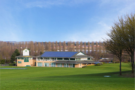 milton: Cricket ground and pavilion in Campbell park in spring, Milton Keynes, England