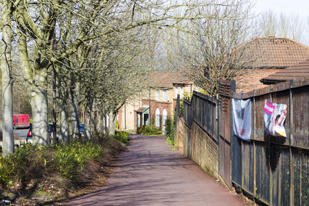 milton: MILTON KEYNES, ENGLAND - MARCH 03, 2015: Sunny view at streets and residential buildings of Two Mile Ash district in spring day, United Kingdom. Editorial
