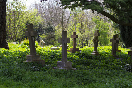churchyard: MILTON KEYNES, ENGLAND - APRIL 22, 2015: View at Holy Trinity Church churchyard with ancient graves and tombs in Old Wolverton, UK.
