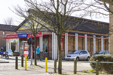 milton: MILTON KEYNES, ENGLAND - MARCH 03, 2015: Sunny view at local supermarket One Stop and people near in Two Mile Ash district on spring day, United Kingdom. Editorial