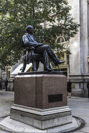 openspace: London, England - November 02, 2015: Bronze statue of American philanthropist George Peabody, seated in a chair, by sculptor William Wetmore Story, UK Editorial