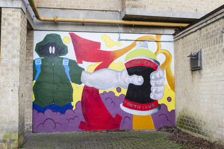 milton: Milton Keynes, England - February 16, 2016: Greenleys Local Centre wall covered with graffito in spring day, UK