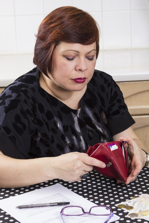 pay bills: Depressed broke woman without enough money to pay bills