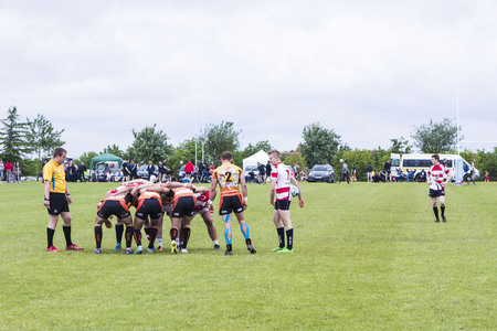 milton: MILTON KEYNES, ENGLAND - JUNE 18, 2016: Rugby team on field during game at MK RUGGERFEST 7s Tournament, festival of sport and music in Emerson Valley Sports Pavilion
