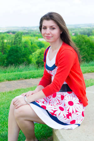 lounging: Charming young brunette lounging outdoors in summer