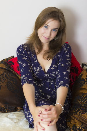 sitter: Indoors portrait of beautiful female with blue eyes