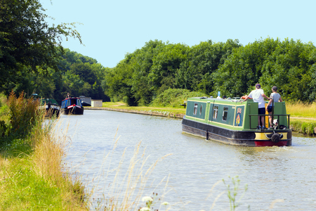 MILTON KEYNES, ENGLAND - JULY 20, 2016: Summer view at ship and boats of Grand Union Canal in New Bradwell residential area