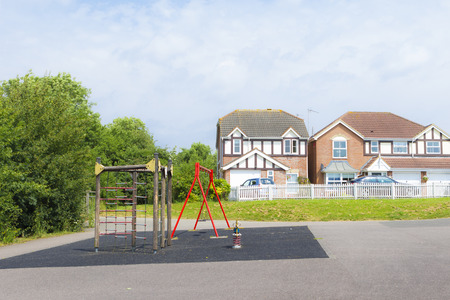 MILTON KEYNES, ENGLAND - JULY 20, 2016: Summer view at New Bradwell residential area with playground and houses in the distance