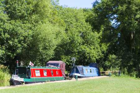 milton: MILTON KEYNES, ENGLAND - AUGUST 26, 2016: Boats parked at wharf of river Ouse in Great Linford, Buckinghamshire. Editorial