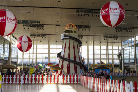 middleton: MILTON KEYNES, ENGLAND - AUGUST 26, 2016: The Beach  in Middleton Hall of Central Milton Keynes Shopping Centre with loads of sand and decorative lighthouse Editorial