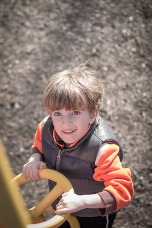 Portrait of a boy at playground Stock Photo