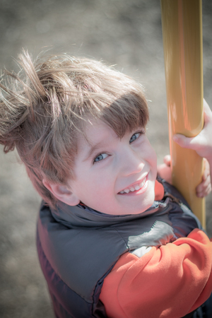 easygoing: Portrait of a boy at playground Stock Photo
