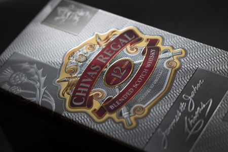 Schaumburg, Il, USA- September 24, 2016, Studio Shot of a box of a Chivas Regal on black background, 12 year old scotch whiskey for editorial use only