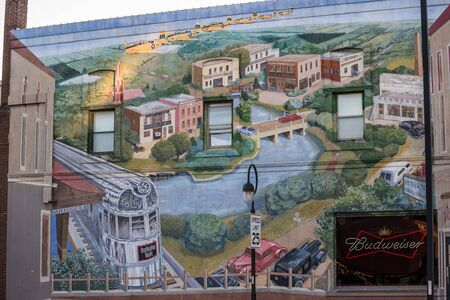 "Naperville, IL, USA, October 22 2016: ""a City in Transit� mural eastern facade of building at Washington Ave and Chicago Ave, Naperville, IL, artists Mariah de Forest & Hector Duarte for editorial use only"