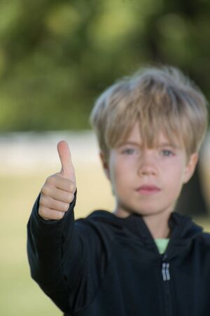 A kid giving a thumb up symbol Banco de Imagens