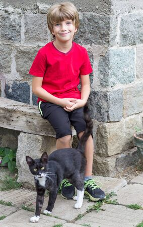 Adorable boy and a cat Banco de Imagens