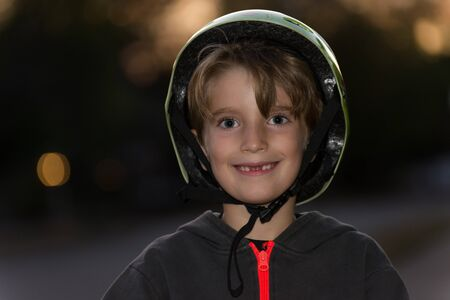 Portrait of a kid wearing a bicycle helmet incorrectly