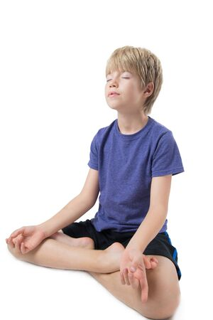 Portrait of a kid meditating on white background Banco de Imagens