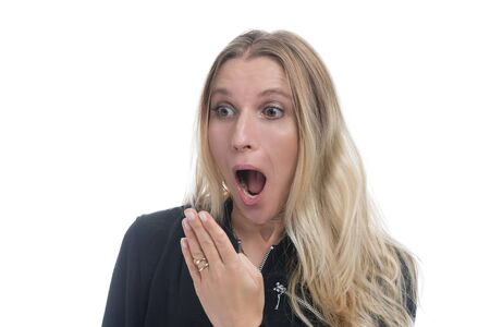 Portrait of a surprised woman with opened mouth and blond hair. Woman in shock, isolated against white background