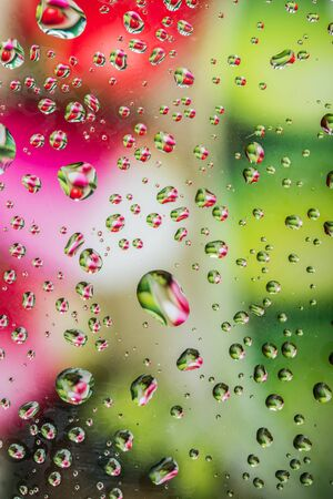 Water drops on glass with colorful background