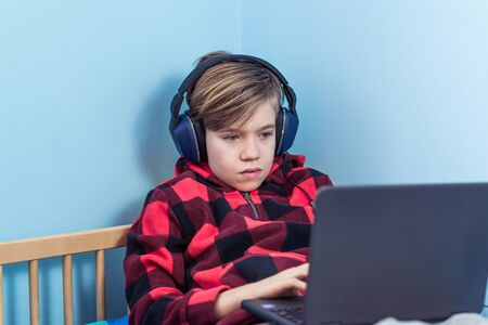 Kid studying from home amid COVID-19 coronavirus crisis