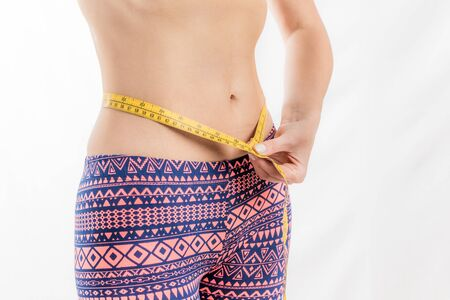Fitness woman measuring her waist, weight loss Banco de Imagens
