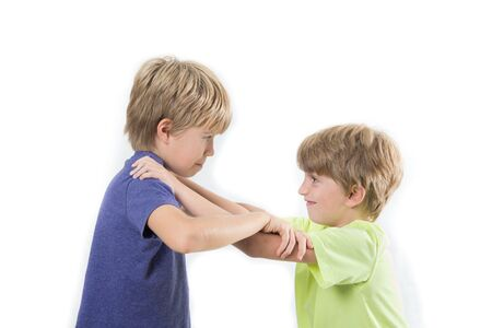 Two kids fighting, siblings, friends fight isolated on a white background