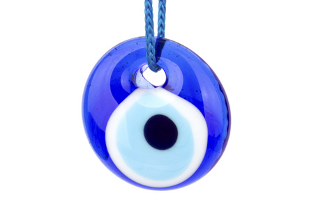 Turkish evil eye pendants amulet on white background.