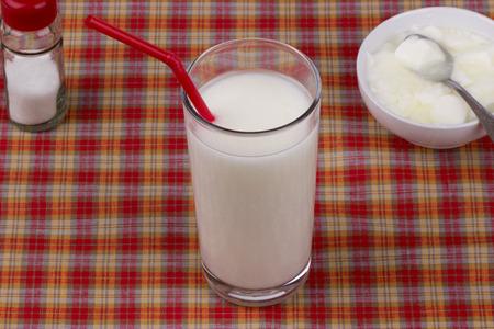 checkered tablecloth: Kefir,yogurt and salt on a checkered tablecloth. Stock Photo