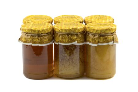 curative: Composition with jars of honey isolated on white background.