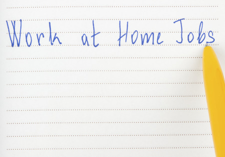 work from home: Handwriting work at home jobs and pen. Stock Photo