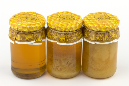 curative: Honey and candied honey on white background.