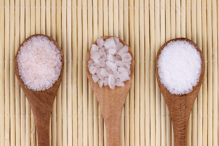 Three spoons with himalayan salt,sea salt and  white salt.