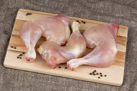 without legs: Raw chicken legs without skin on kitchen cutting board. Stock Photo