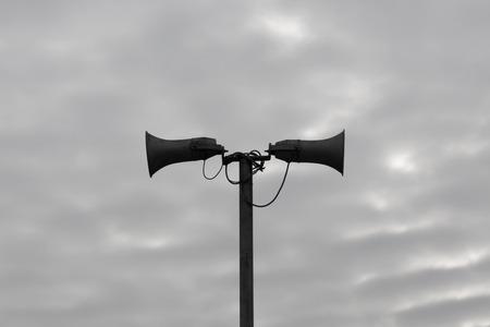 Loudspeaker against the sky clouds. Stock Photo