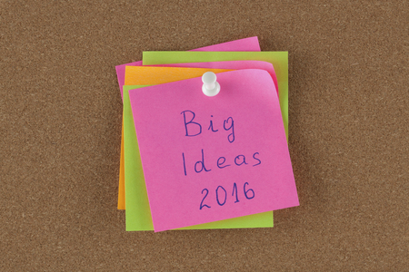 patronage: Color reminder note with pin on cork board big idea 2016. Stock Photo