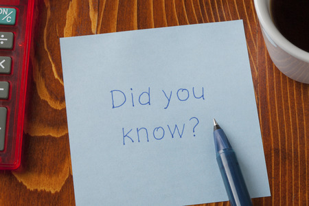 Did you know written on a note on wooden background with pen.