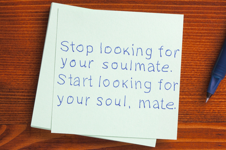 soul mate: Stop looking for your,soulmate.Start looking for your soul,mate written on note. Stock Photo