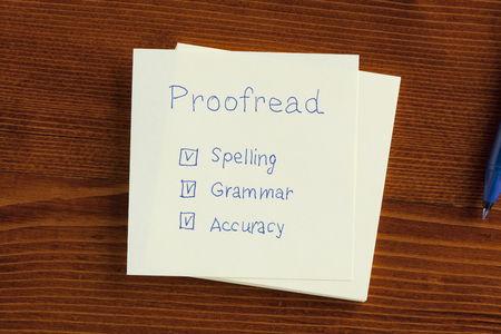 Proofread note with check boxes for spelling, grammar and accuracy.