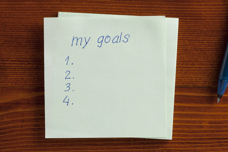 memorize: Top view of my goals written note on the wooden desk with pen aside. Stock Photo