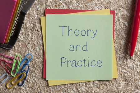 overbalance: Top view of Theory and Practice written note on the wood chippings board.