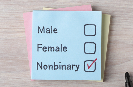 Top view of Male,Female and Non binary handwritten on a note. Stock Photo - 90073730