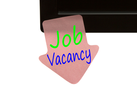 Job Vacancy written in reminder sticky note  on monitor isolated on white background.