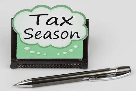 Tax Season written in talk bubble on white background.