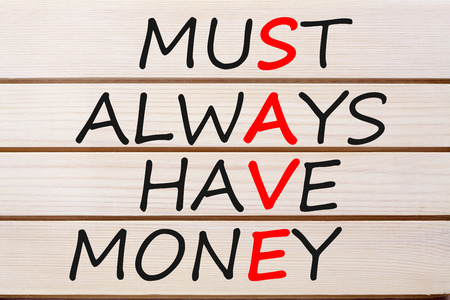 Save Must Always Have Money acronym written on wood wall decor.